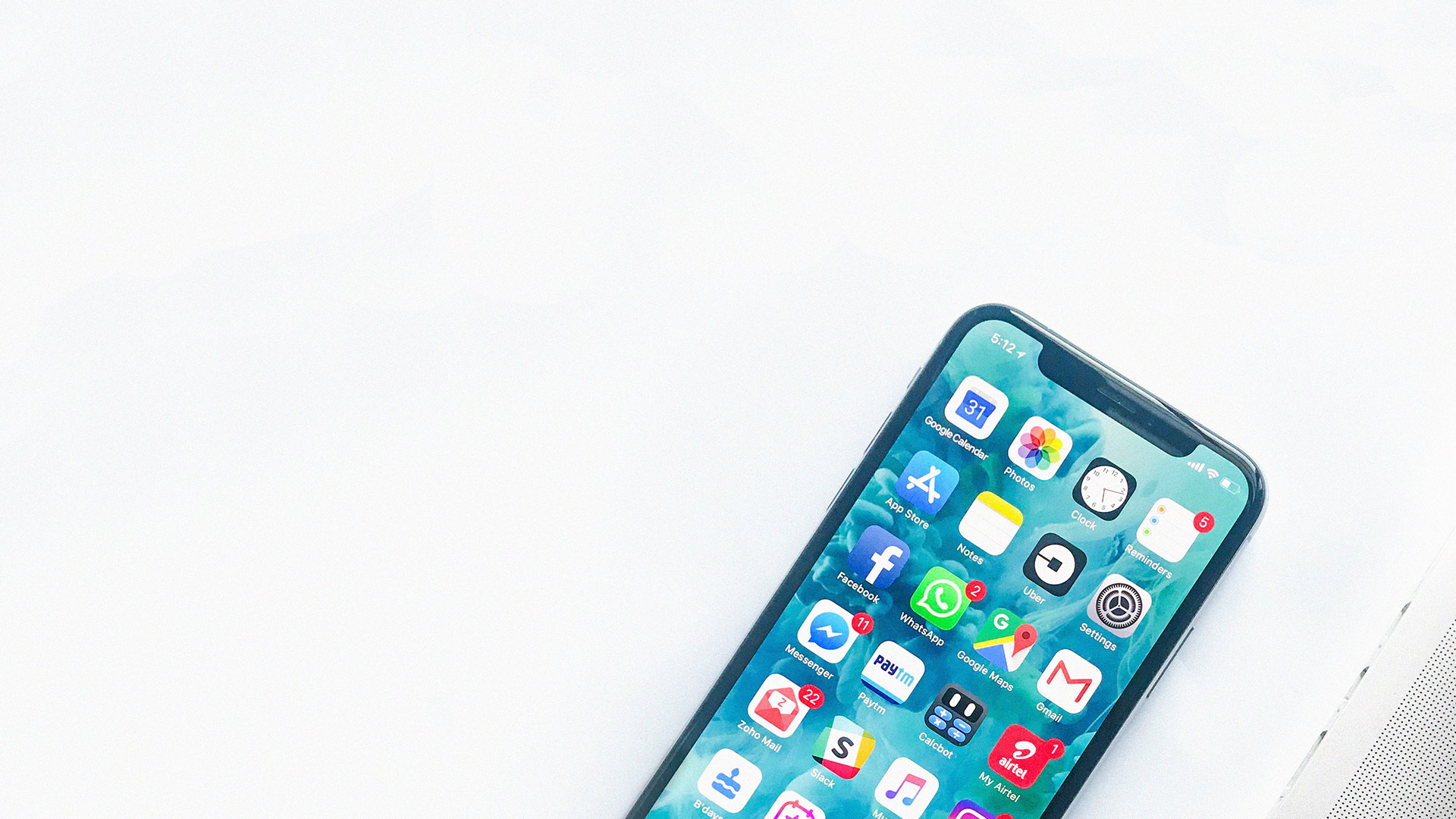 Smartphone with apps next to a computer