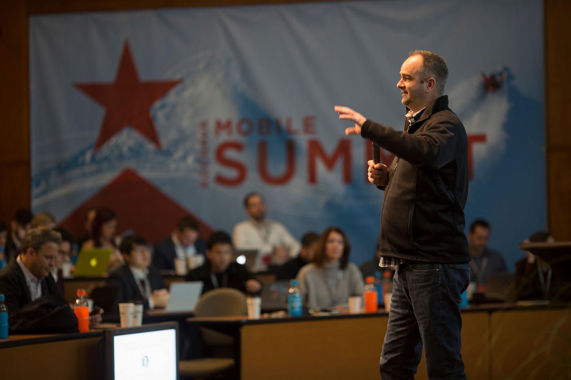Charles Mannings speaking on stage at the Kochava Summit