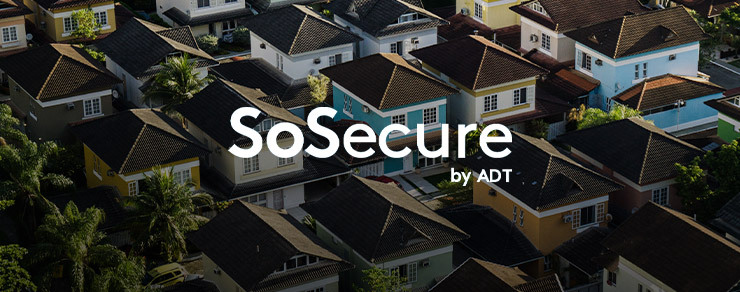 Neighborhood with colorful houses and SoSecure by ADT white logo