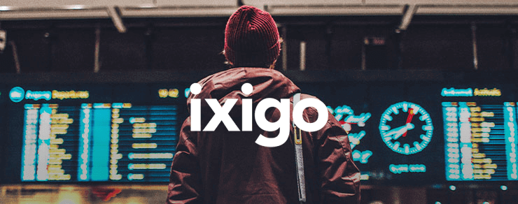 Person looking at a transportation schedule and Ixigo white logo
