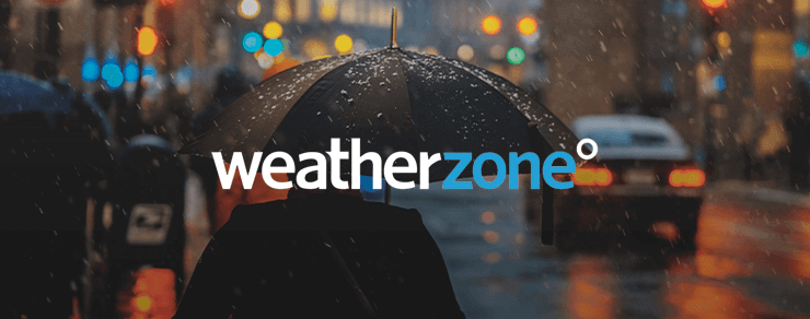 Dark rainy street with an umbrella and cars and WeatherZone colored logo