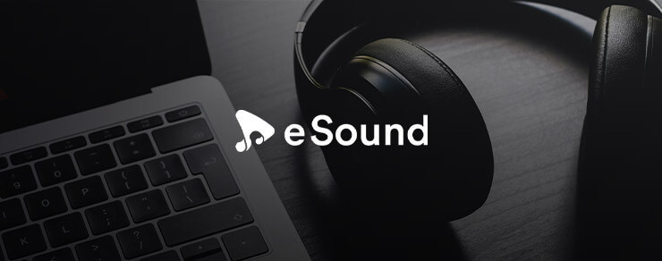 Black and white computer and headphones with eSound white logo